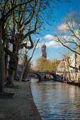 Sunny winterday canals in dutch Utrecht with view on dom