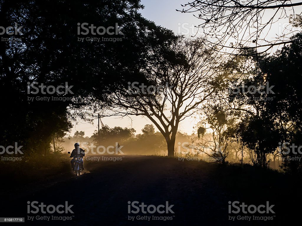 Sunrays  and a motorcycle royalty-free stock photo