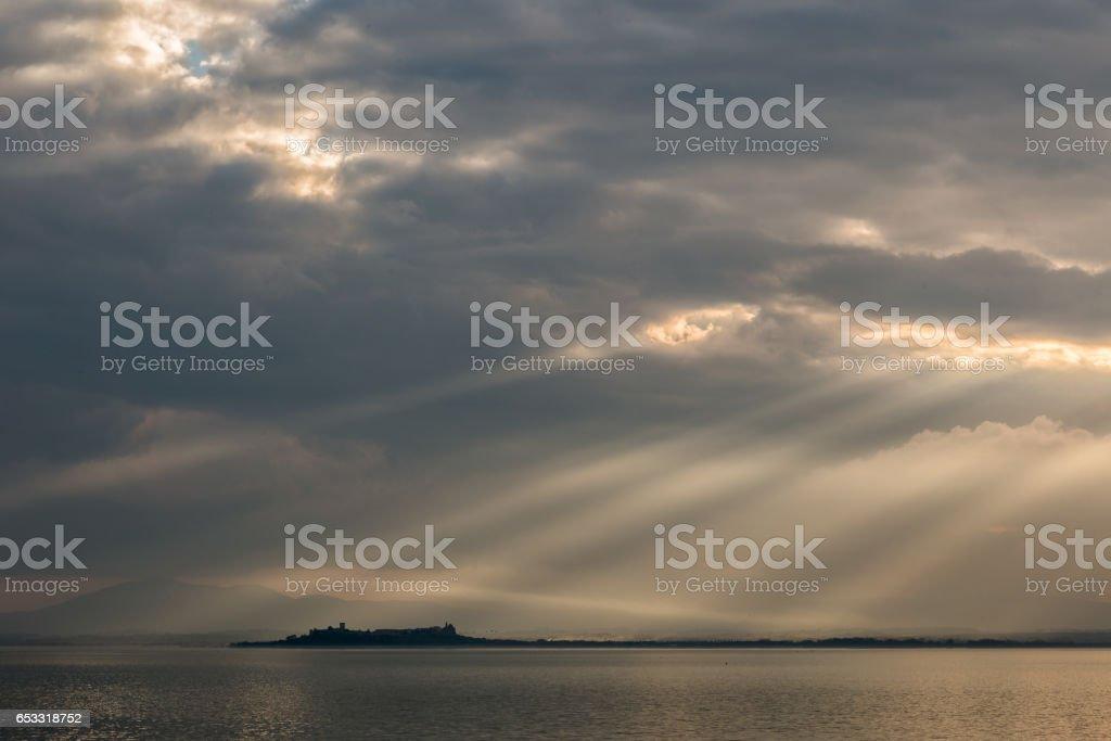 Sunrays at the lake stock photo