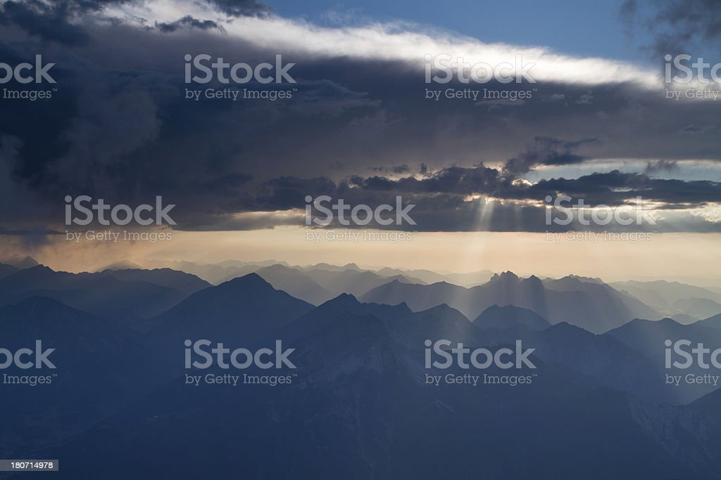 sunrays break through clouds stock photo