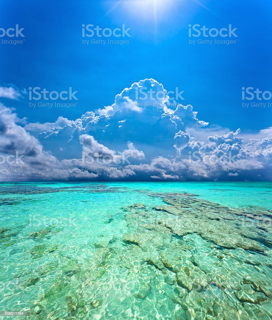 Sunrays on a Tropical coral island beach royalty-free stock photo
