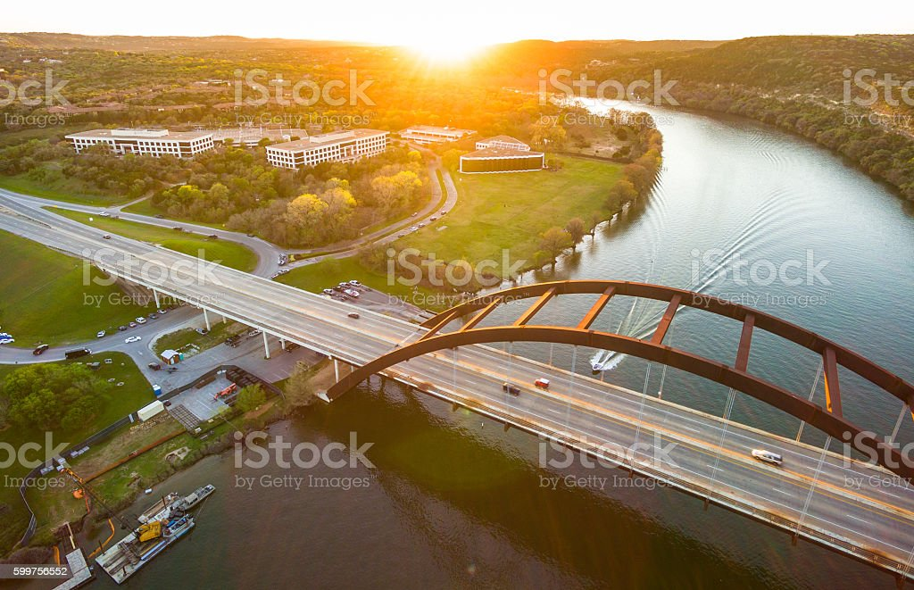 Sunrays Over Pennybacker Bridge Austin Texas Landmark at Sunset stock photo