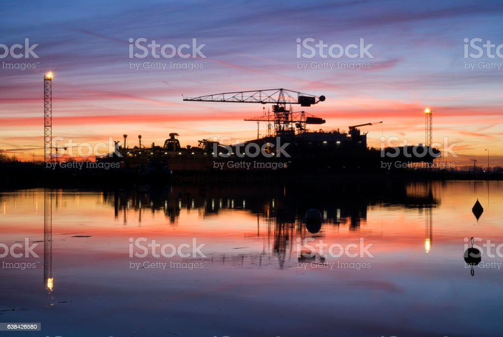Sunrise above a shipyard stock photo