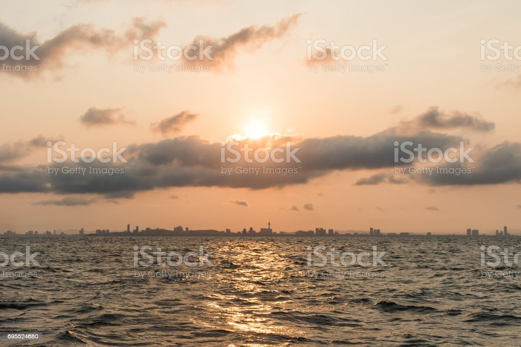 Sunrise above Pattaya city on morning , view from KhoLan Island. stock photo