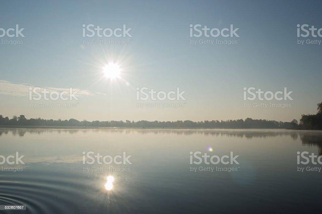 Sunrise above river stock photo