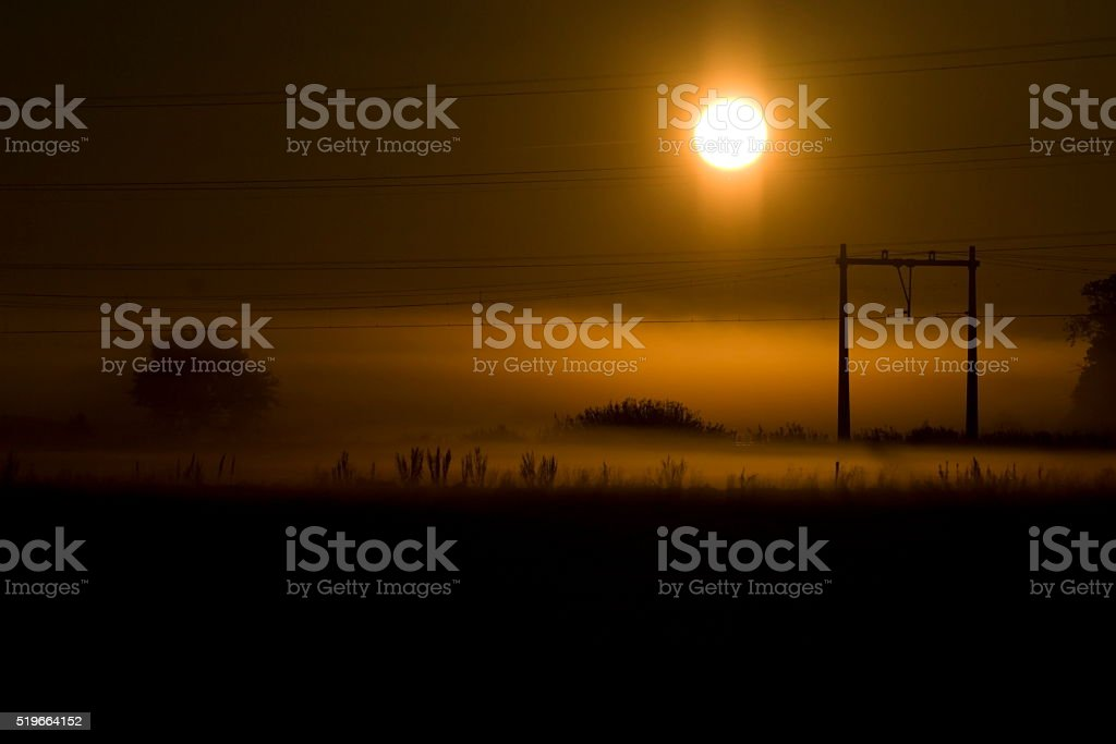 Sunrise above the train tracks stock photo