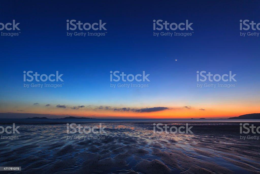 Sunrise and beach at sea stock photo