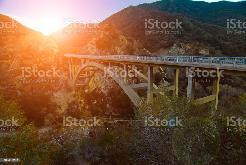 Sunrise and Bridge in Mountains stock photo