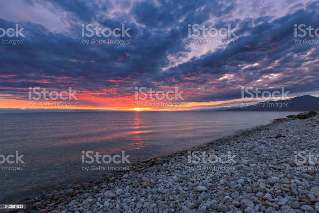 Sunrise and dramatic sky at the Issyk Kul Lake, Kyrgyzstan stock photo