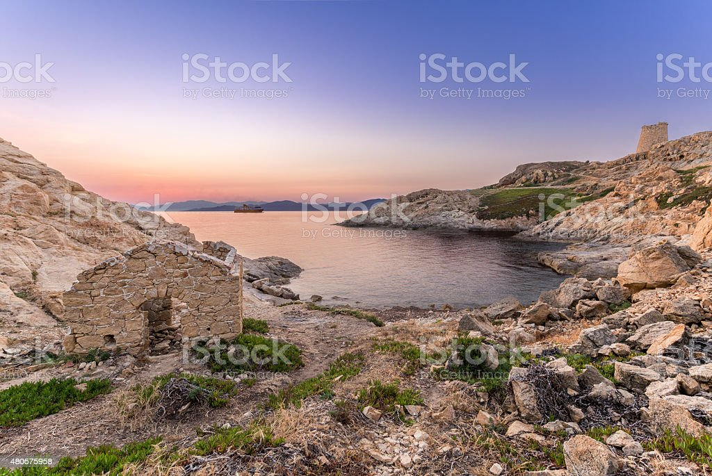 Sunrise and ferry at Ile Rouse in Corsica stock photo