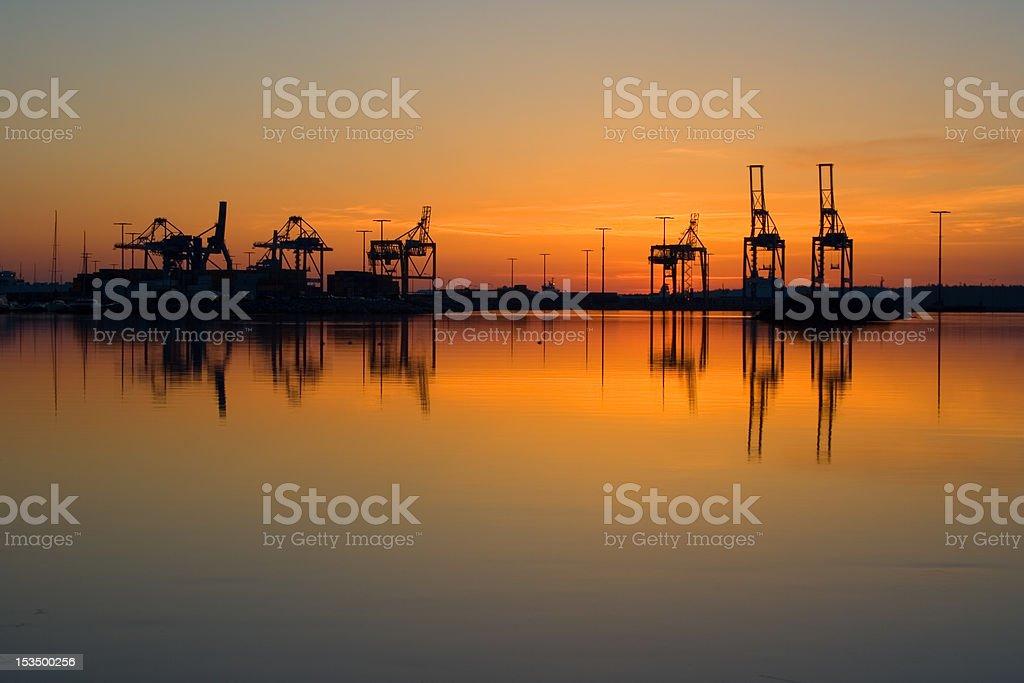 Sunrise and harbor royalty-free stock photo