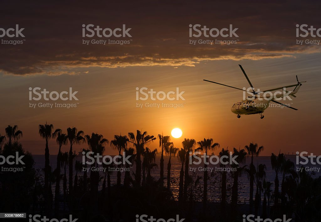 sunrise and helicopter stock photo