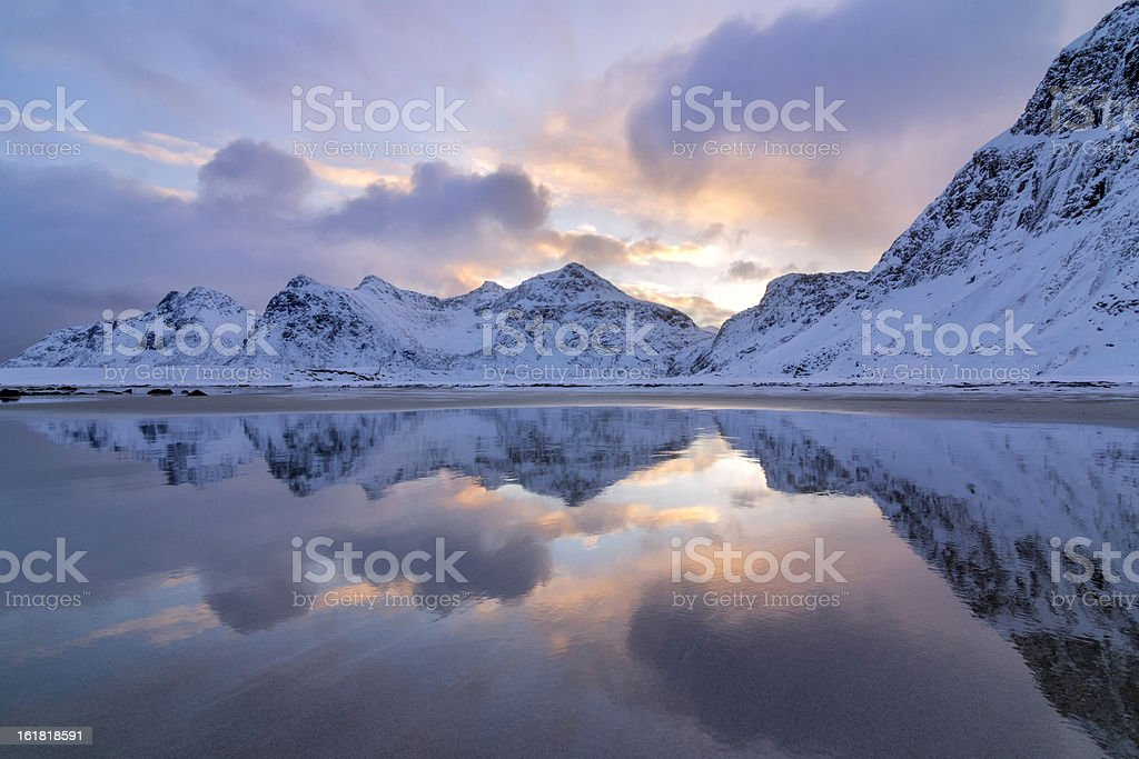 Sunrise and Mountains Reflected in Sand stock photo