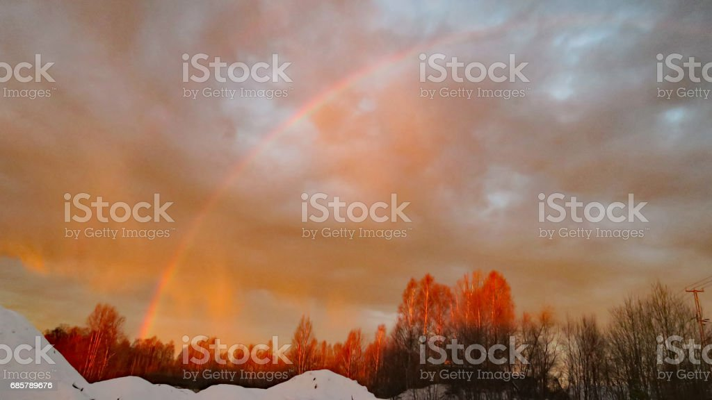 Sunrise and rainbow - from a sawmill in the small swedish town Mora in the county Dalarna. stock photo