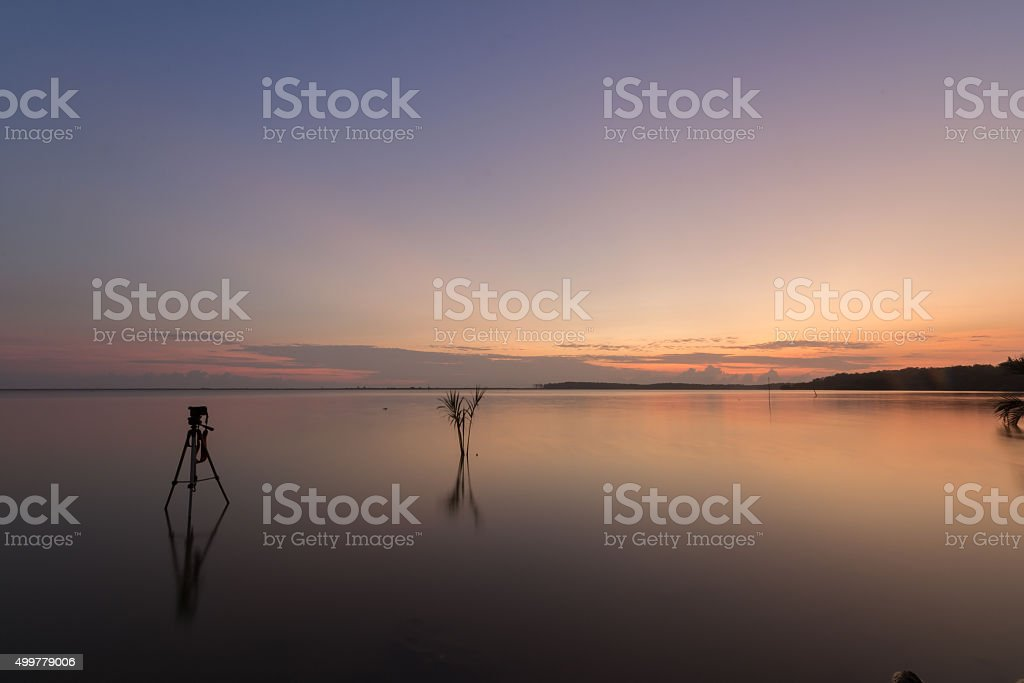 Sunrise at a beach with tripod stock photo
