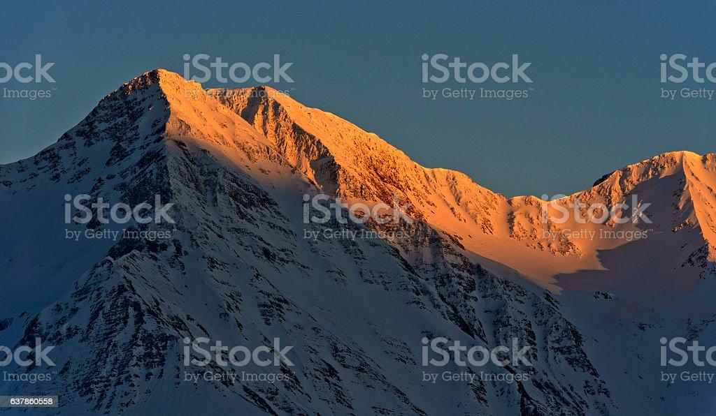 Sunrise at a snow-covered peak stock photo