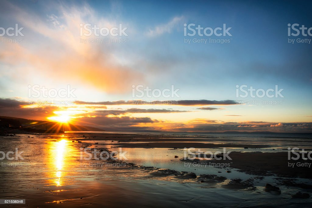 Sunrise at Amroth Beach Pembrokeshire South Wales UK stock photo