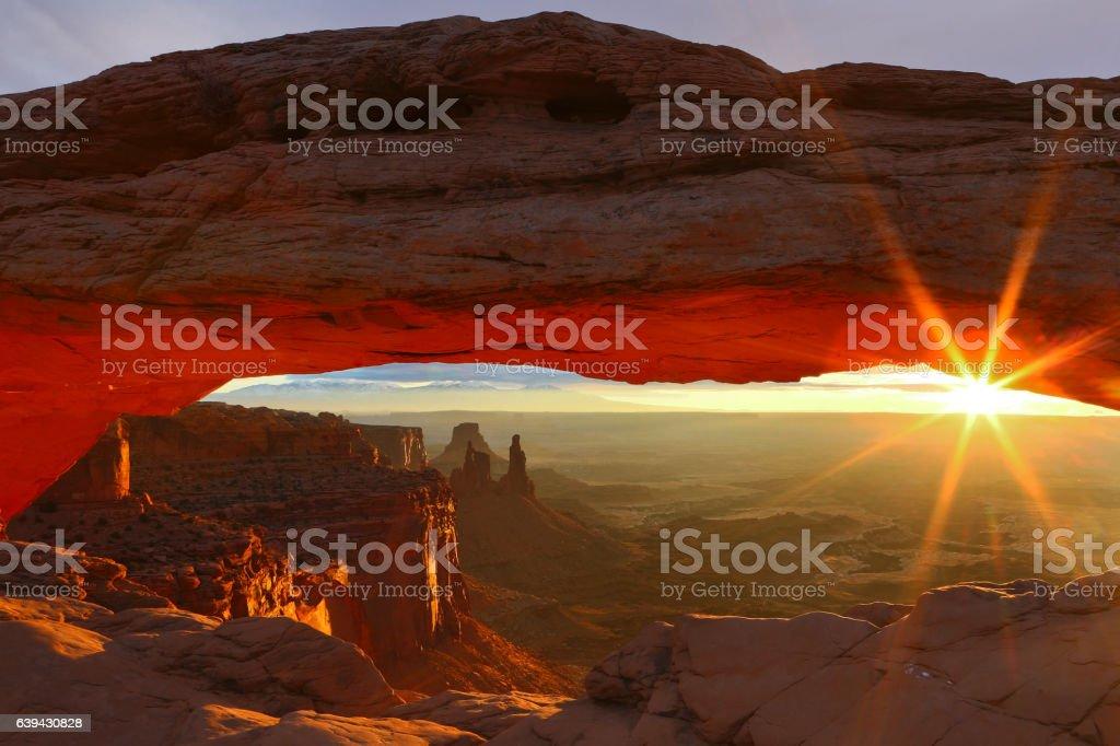 Sunrise at Canyonlands National Parks iconic landmark Mesa Arch stock photo