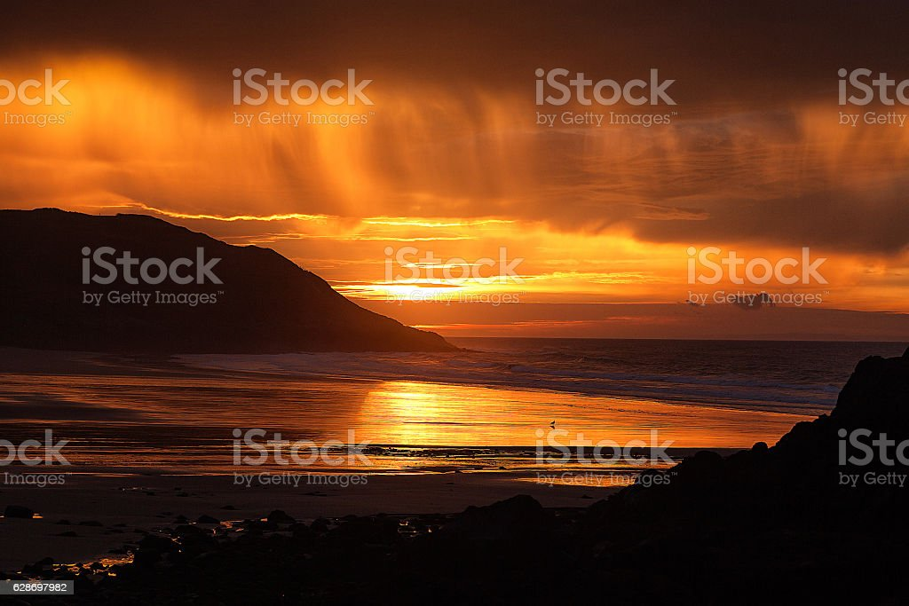 Sunrise at Caswell Bay stock photo