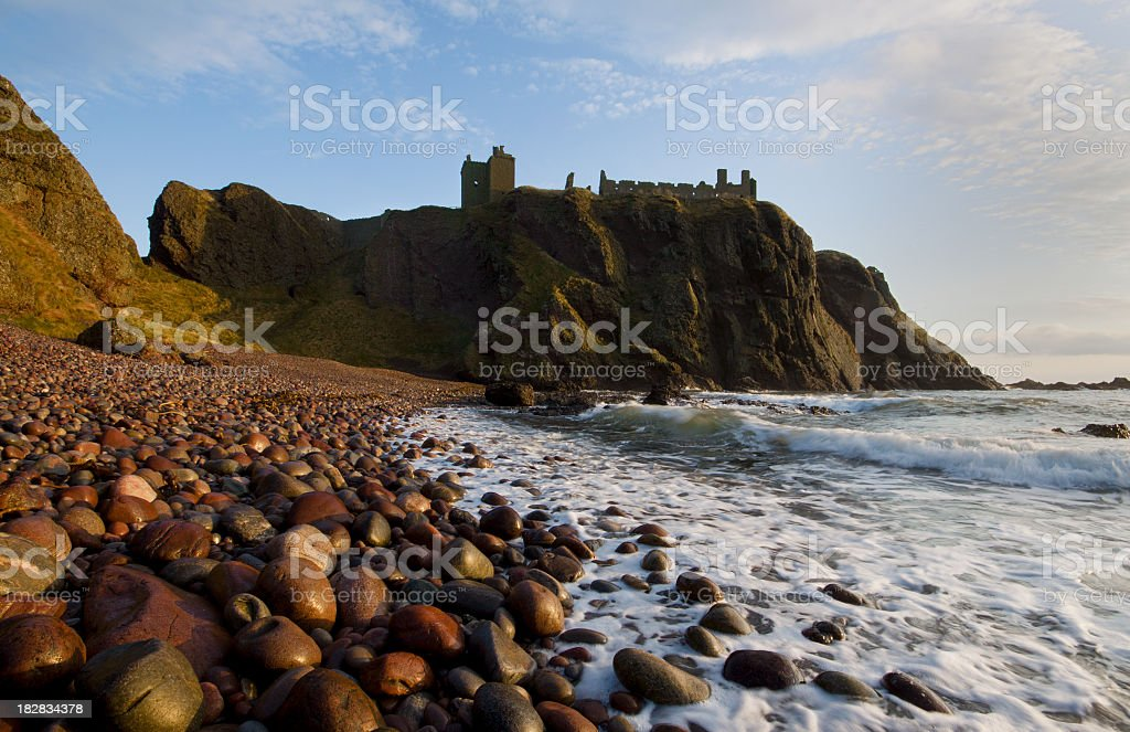 Sunrise at Dunnottar Castle on the East coast of Scotland. stock photo