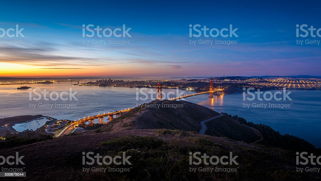 Sunrise at Golden Gate Bridge and city of San Francisco stock photo