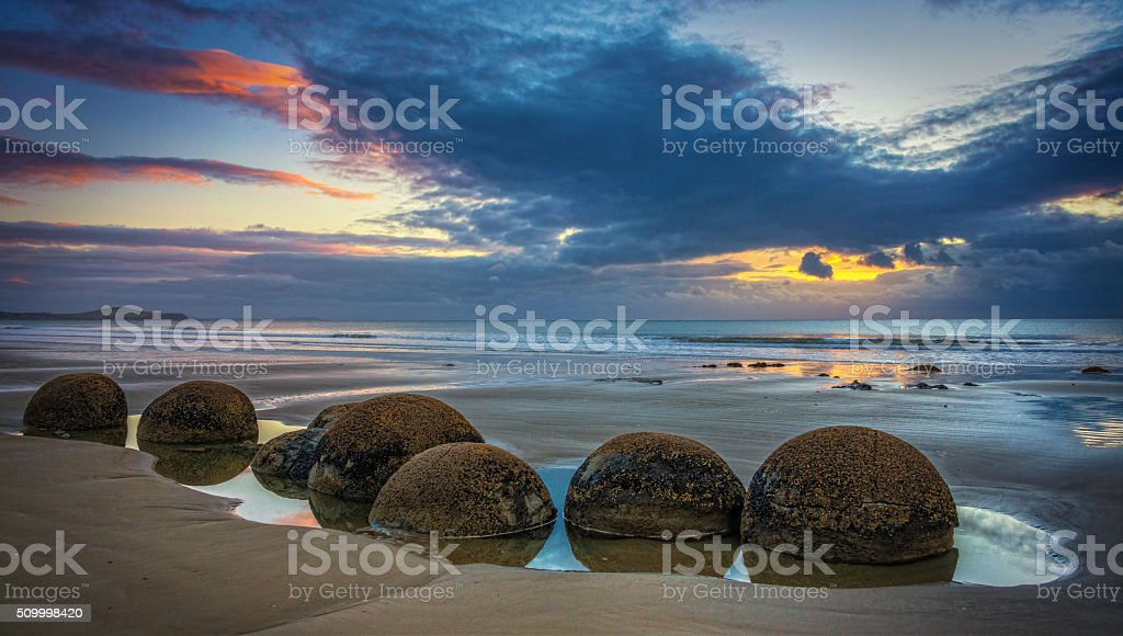Sunrise At Hampden Beach With Moeraki Boulders stock photo