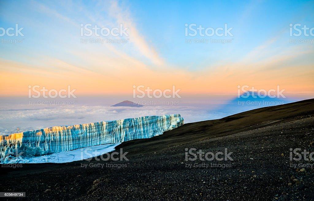 Sunrise at Kilimanjaro with glacier and Mount Meru - Tanzania stock photo