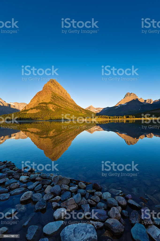 Sunrise at Many Glacier in Glacier National Park, Washington, USA stock photo