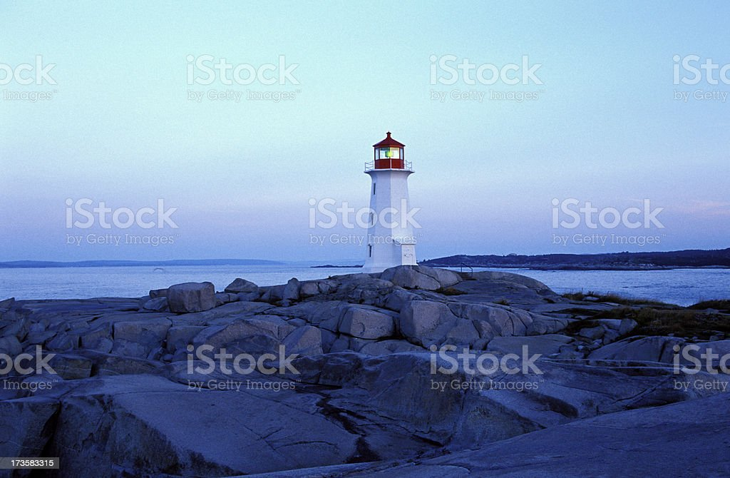 Sunrise at Peggy's Cove Lighthouse royalty-free stock photo