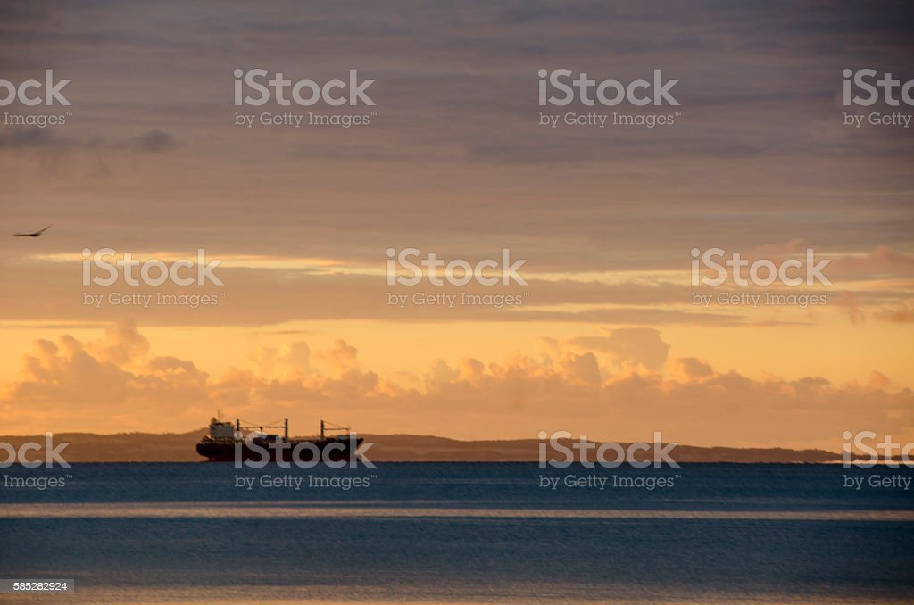 Sunrise at Sea in the Nordic countries with a tanker in the horisont