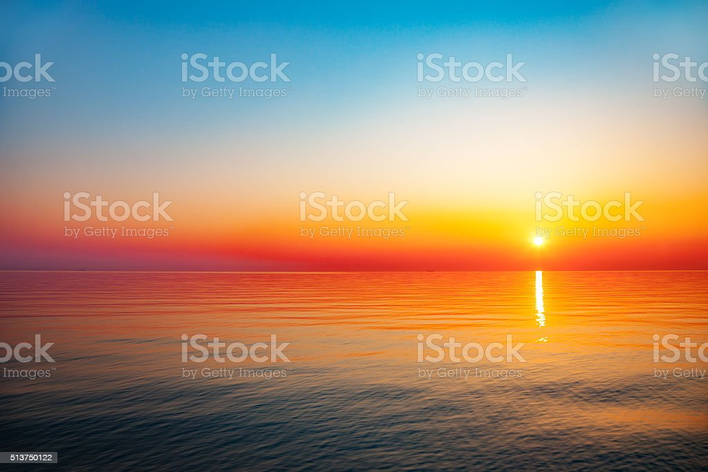 Sunrise at sea stock photo