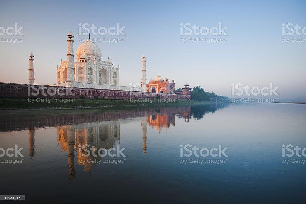 Sunrise at Taj Mahal on Jamuna river stock photo