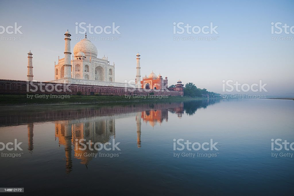 Sunrise at Taj Mahal on Jamuna river stock photo