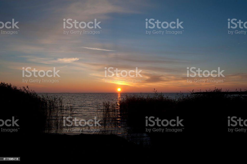 Sunrise at the bay of Ahrenshoop in Germany stock photo
