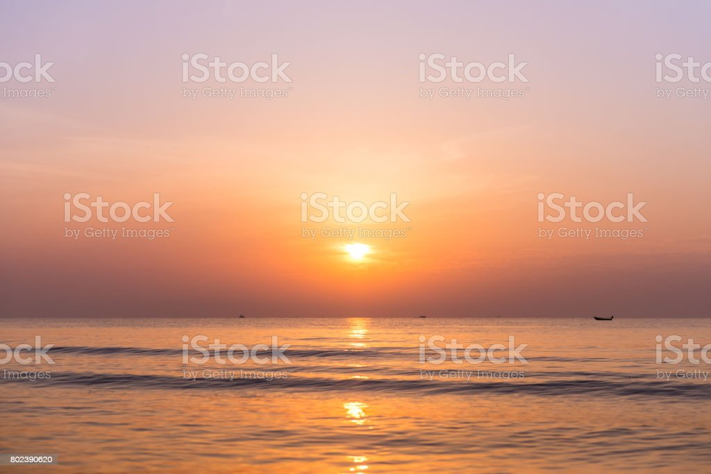 Sunrise at the Sea and cloudy sky stock photo