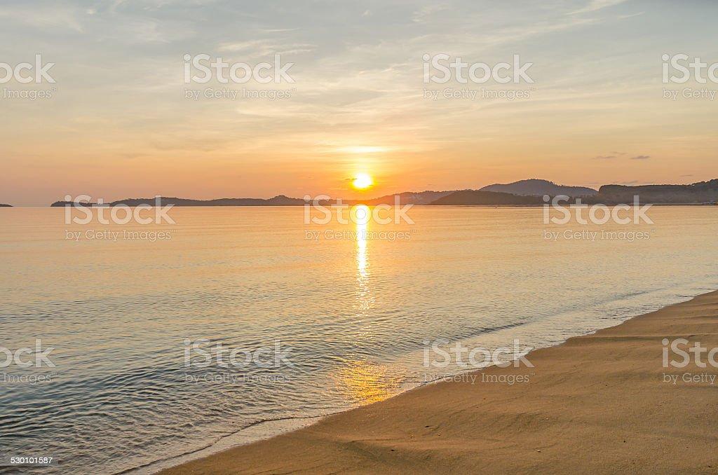 Sunrise behind mountain stock photo