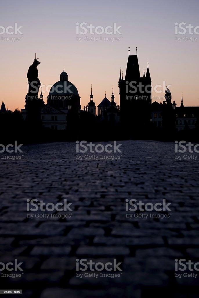 Sunrise behind Prague from Charles Bridge stock photo