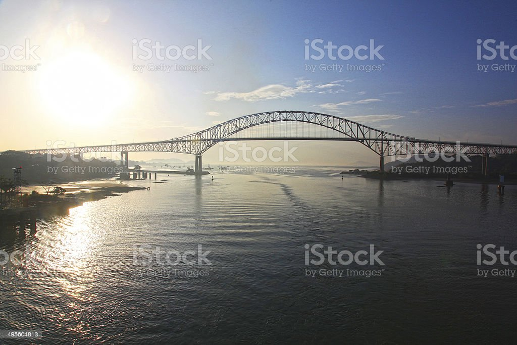 Sunrise behind the Bridge of the Americas, Panama Canal. stock photo