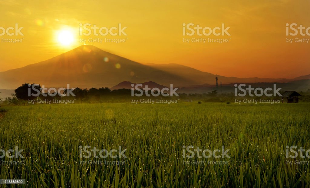 sunrise behind the hill stock photo