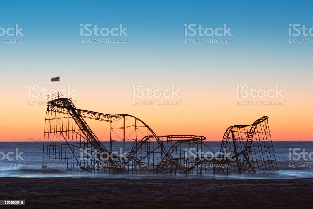 Sunrise behind the iconic Jet Star roller coaster after hurricane Sandy stock photo
