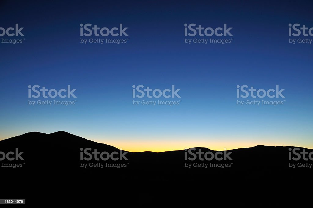Sunrise Behind the Mountains stock photo