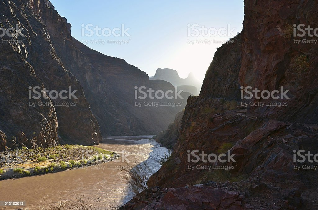 Sunrise Filling Grand Canyon's Inner Gorge along Bright Angel Trail stock photo