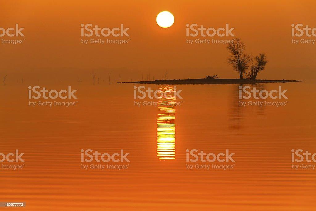 Sunrise Fog on Truman Lake with an Island stock photo