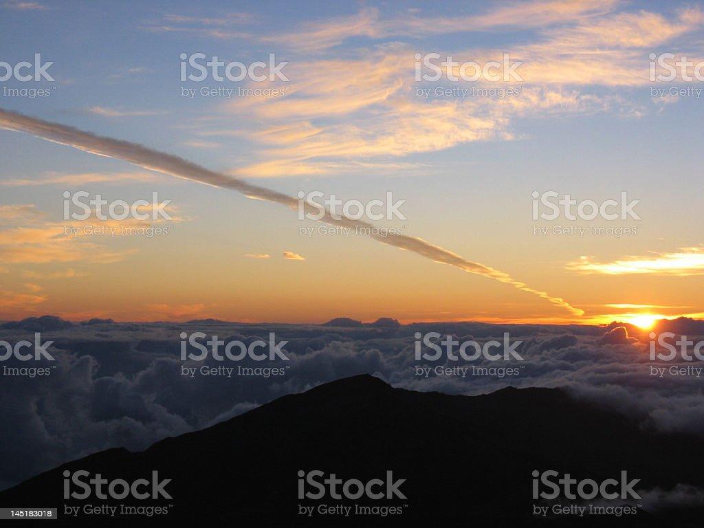 Sunrise from Haleakela with vapor trail stock photo