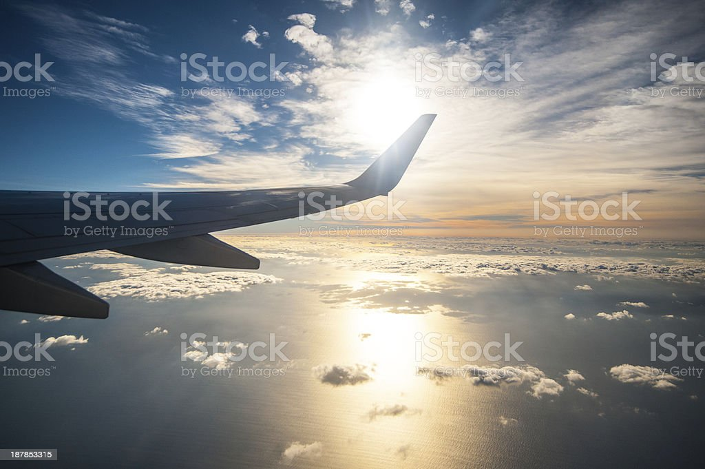 Sunrise from inside an airplane stock photo