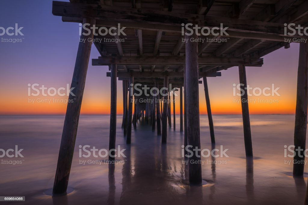 Sunrise from underneath Nags Head. stock photo