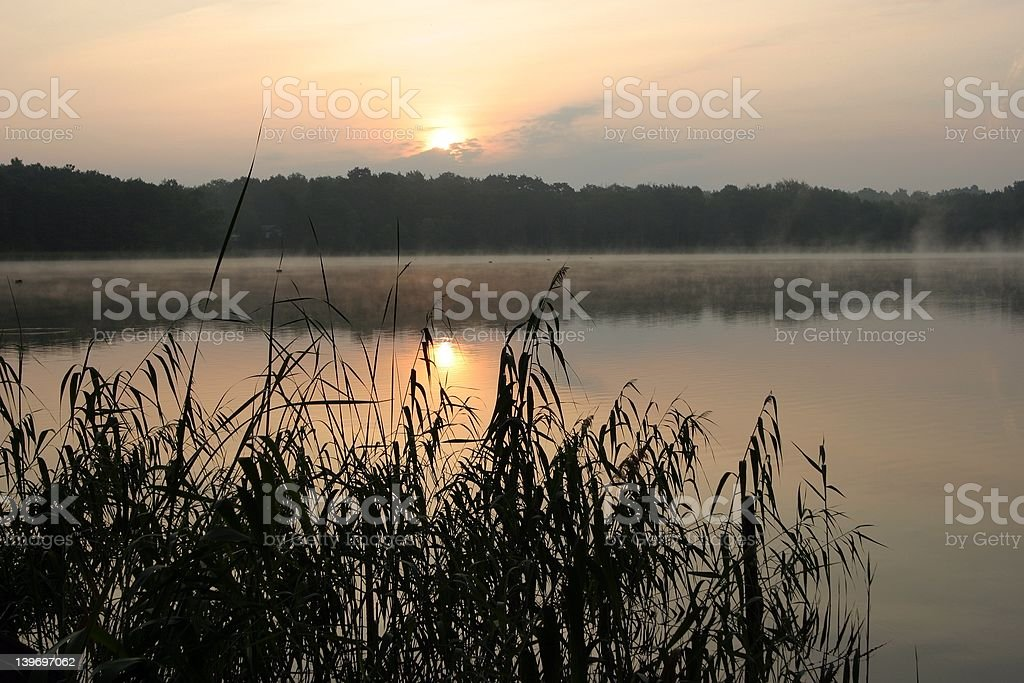 sunrise idyll at fishing lake stock photo