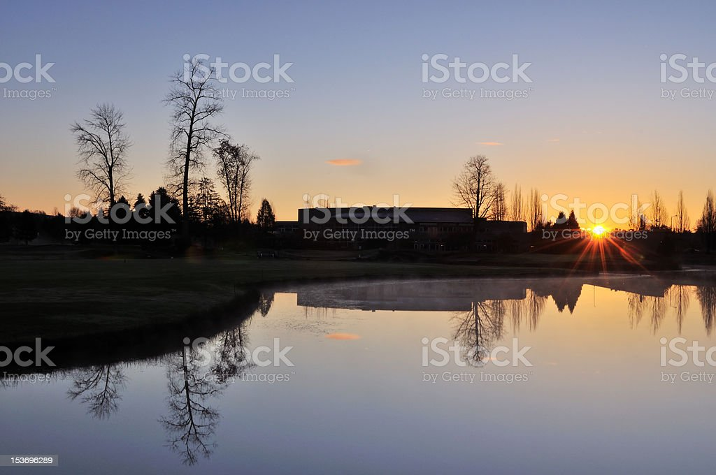 sunrise in a golf center stock photo