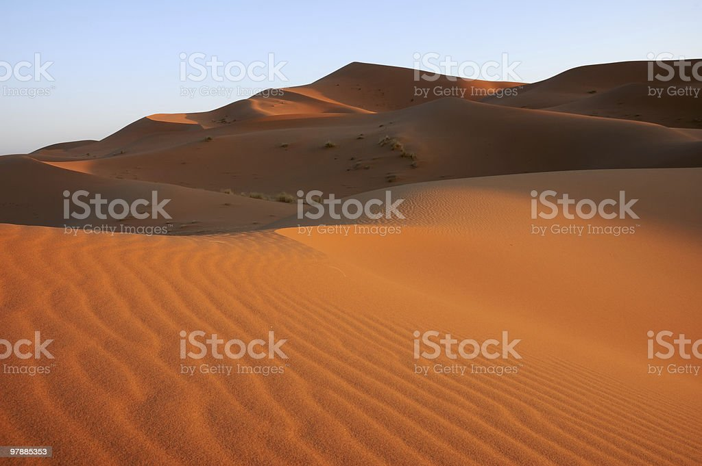 Sunrise in a sea of sand stock photo