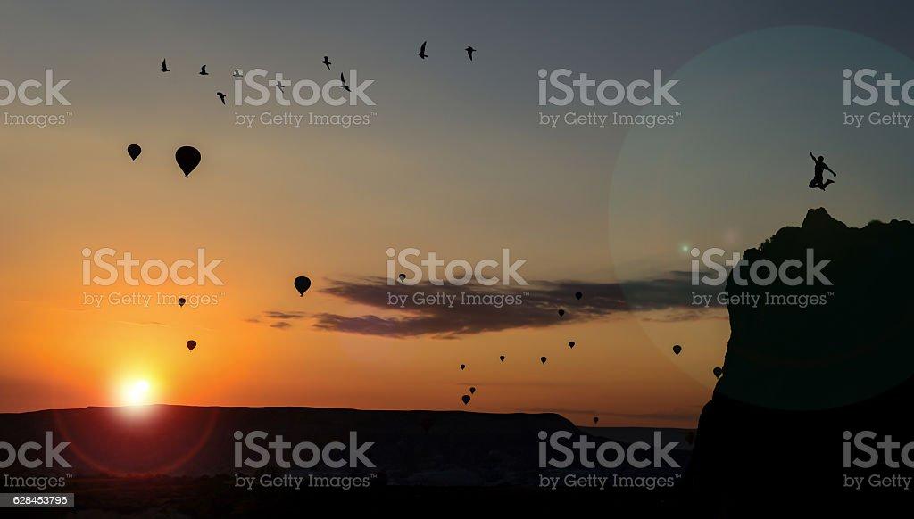 Sunrise in Cappadocia and balloons stock photo